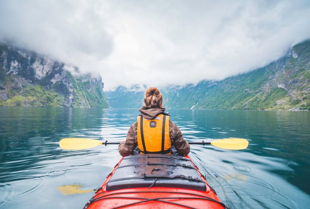 Kayaking in Geiranger fjord in Norway.