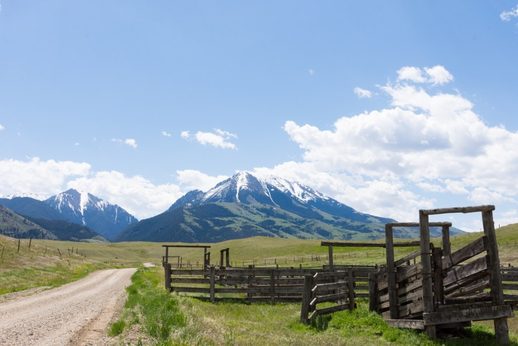Old Wooden Corral with Rugged Mountains