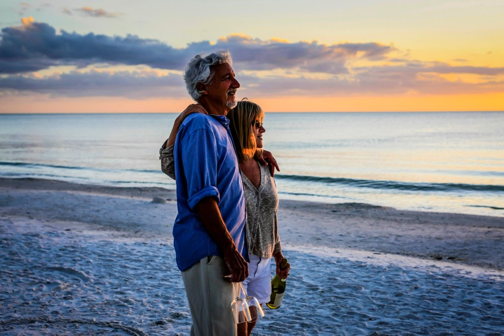 Active retirees enjoy the sunset on Siesta Key beach