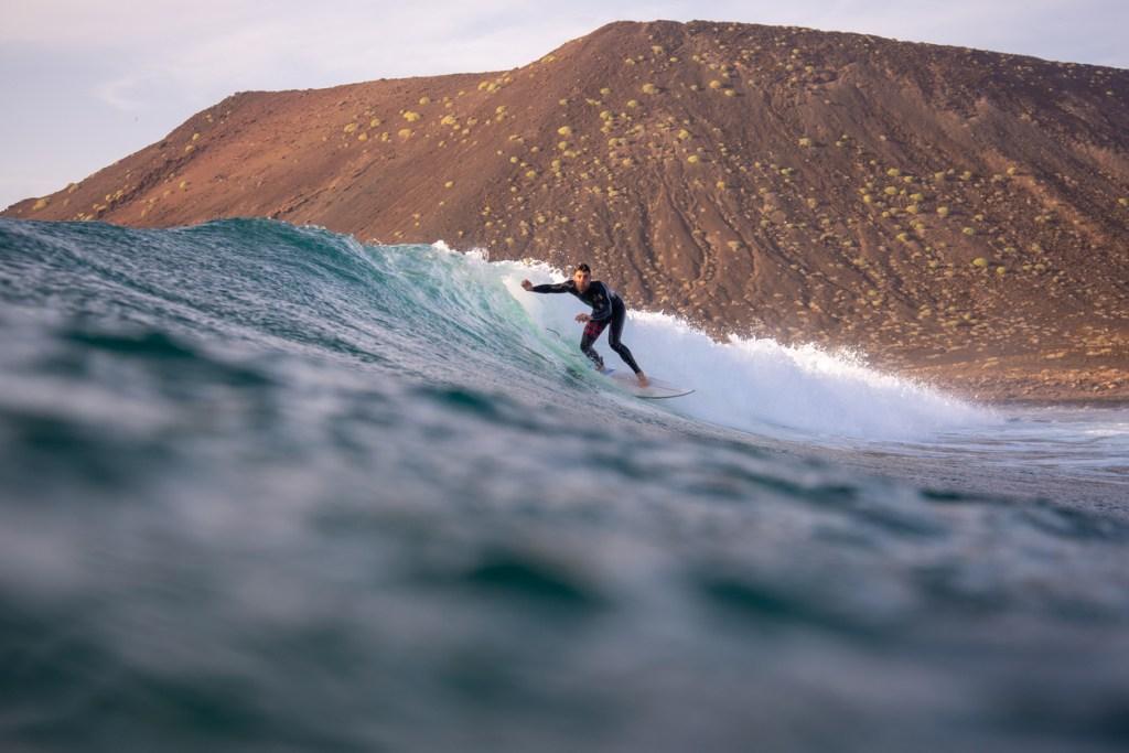 Surfer riding waves on the island of Fuerteventura