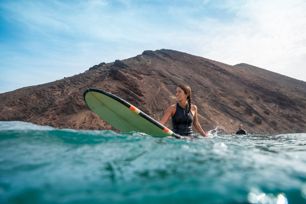 Woman surfing in Fuerteventura