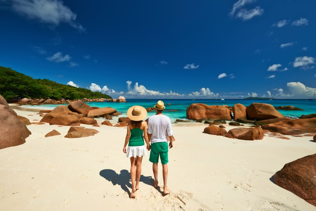 Walking on a beach in the Seychelles