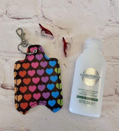 Picture of rainbow hearts hand sanitiser case made from vegan leatherette