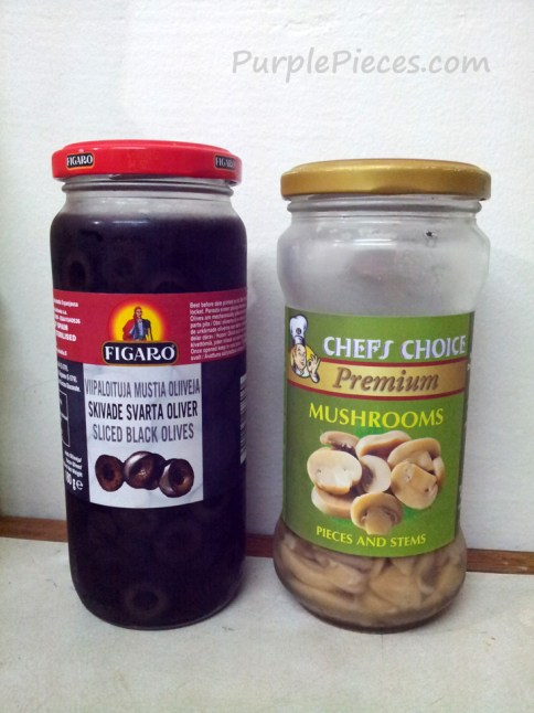Mushroom and olives in bottle