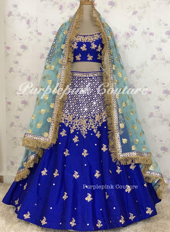 Royal Blue Raw Silk Complete Hand Mirror Embroidered Lehenga Choli Net Blue Zhalar Dupatta
