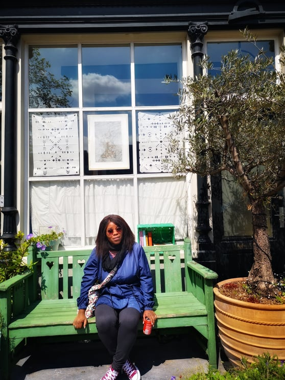Sheri Weekend in Amsterdam. sitting on green bench