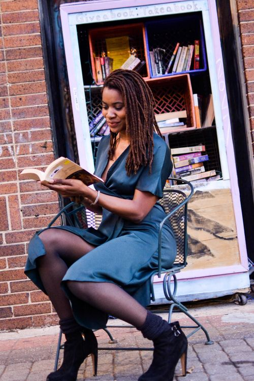 Woman in front of store, Ebony woman, Manage a successful blog by being productive