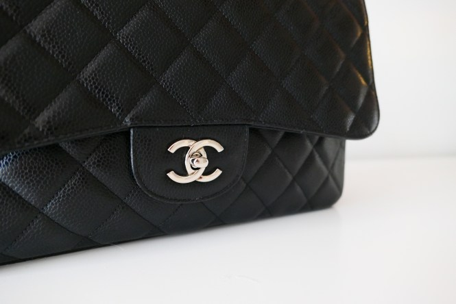 Chanel Jumbo classic flap bag in black caviar leather with silver hardware.