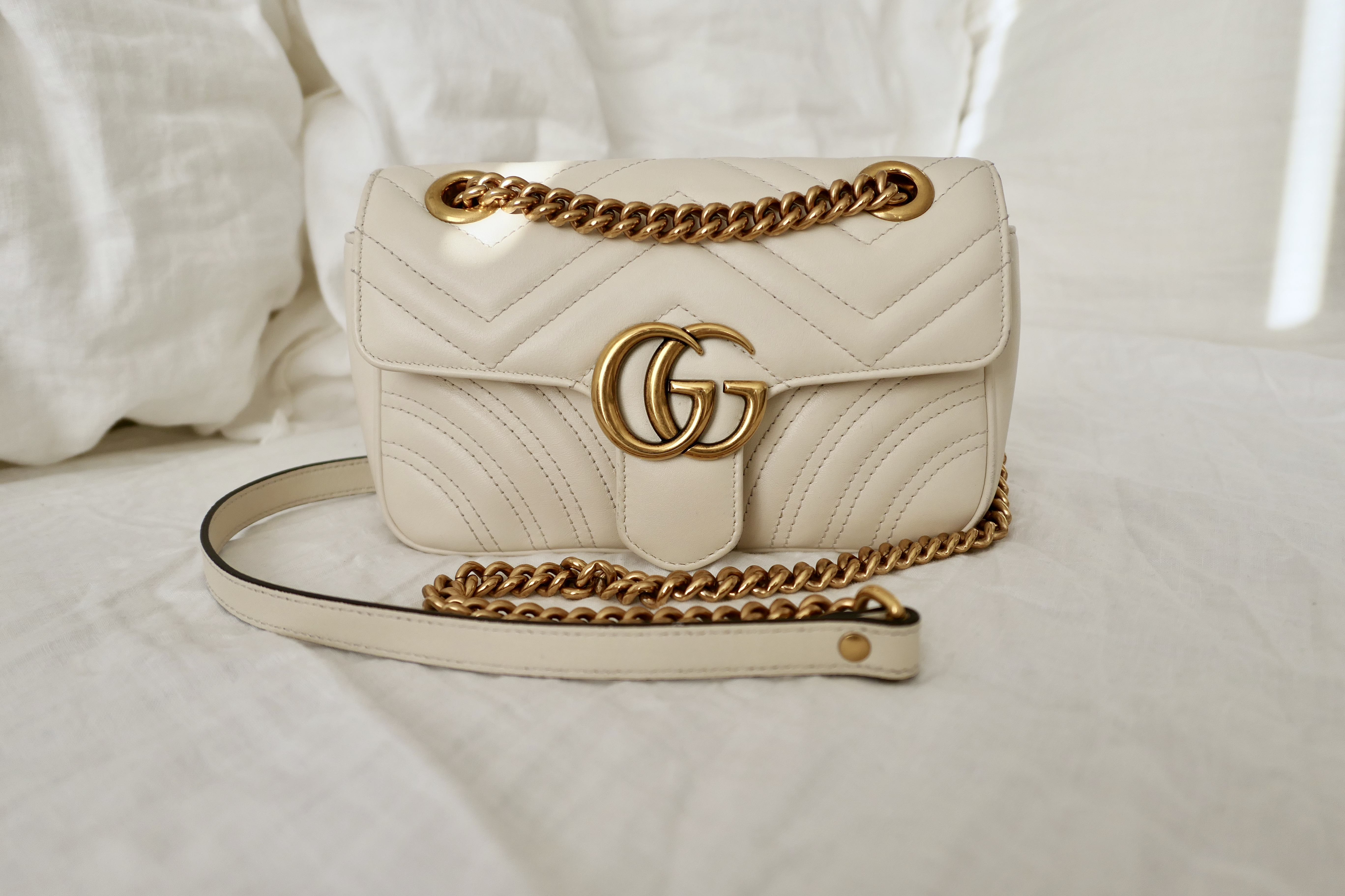 7d8601c3550a83 Gucci Marmont in ivory with gold hw, mini size.