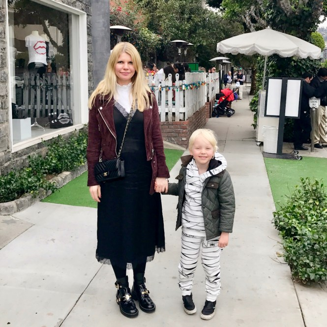 Mommy and son on holiday in LA, having lunch at the Ivy. Wearing Balenciaga Ceinture cut out boots,.