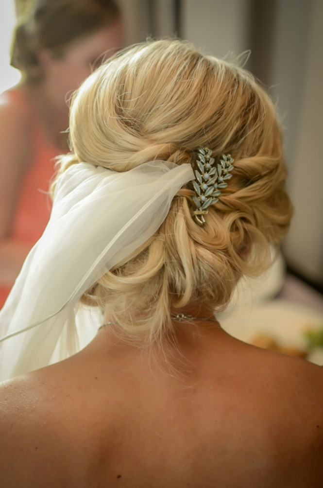 Wearing a vintage brooch in wedding hair.