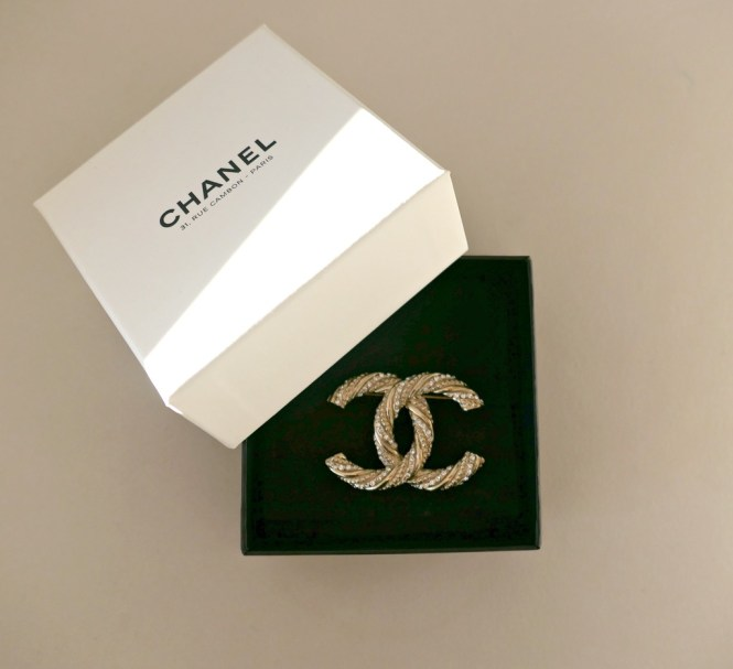 chanel brooch in a chanel white box