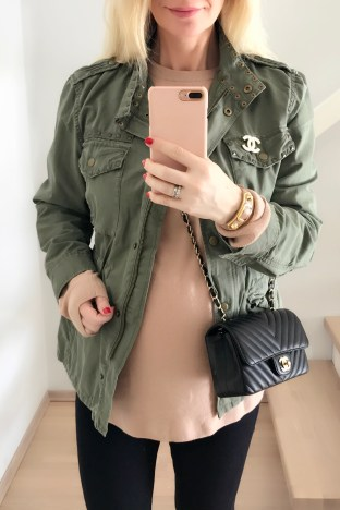 Pregnant style. Military green utility jacket with a Chanel brooch and Chanel chevron mini rectangle bag.