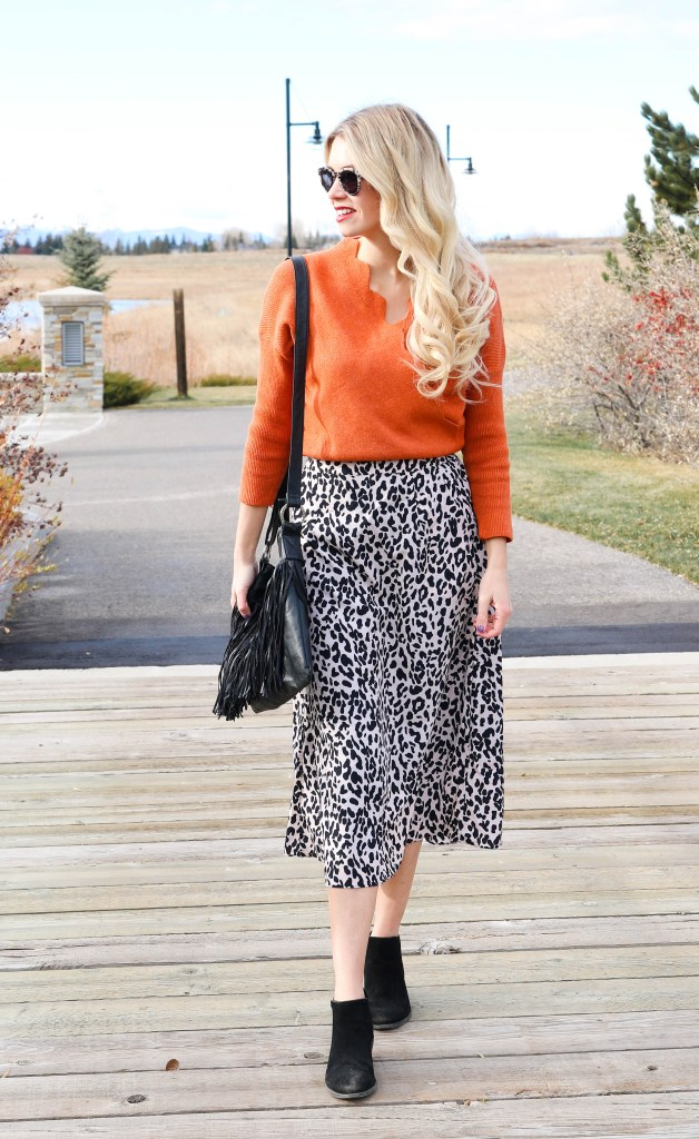 Mixing patterns this fall! Click over to the blog to see where this gorgeous orange sweater and leopard skirt are from! Affordable fall fashion at it's best!
