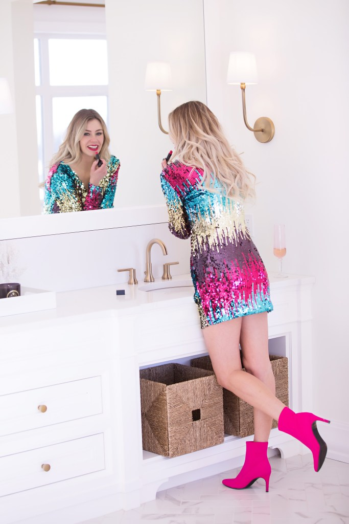 Putting a twist on cocktail attire!  Wow them in this sequin dress for only $27 and these hot pink sock boots for only $34!