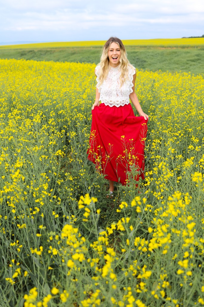 Photoshoot in the Canola Fields in Alberta. Summer flower field photos in the Prairies. #style #fashion