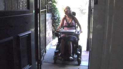 Woman entering ramped doorway