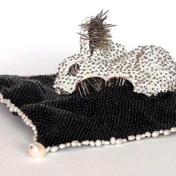 Sari Liimatta, jewellery sculpture ''Memento mori''-glass beads, fresh water pearls, pins, a plastic toy, thread (polyamide)