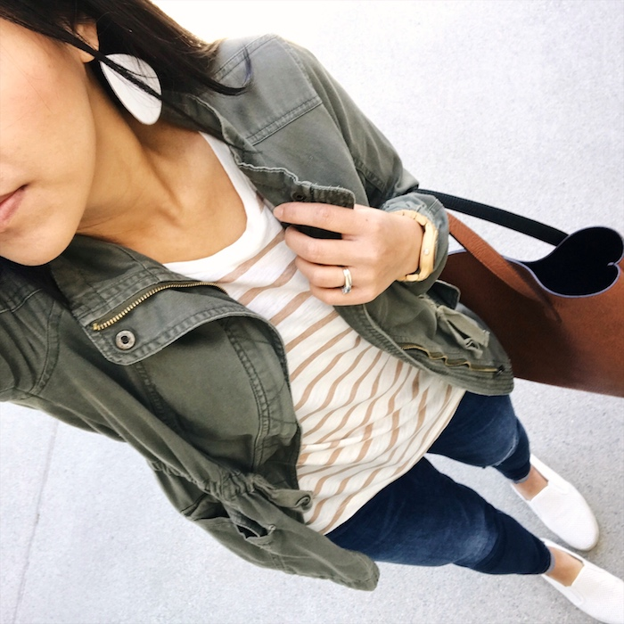 striped tee + utility jacket + white sneakers + jeans
