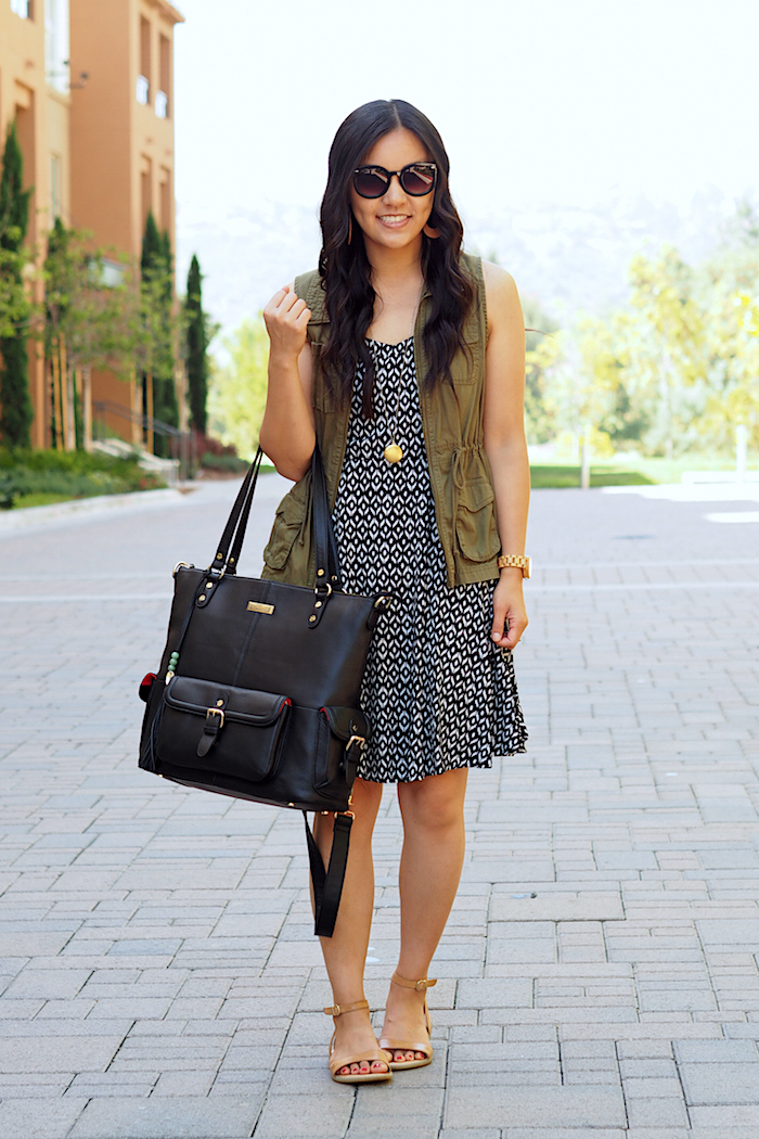 neutral printed dress + utility vest + tan sandals