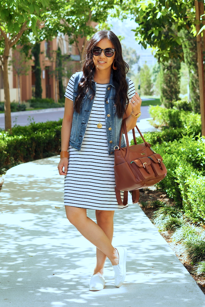 striped t-shirt dress + denim vest + white sneakers