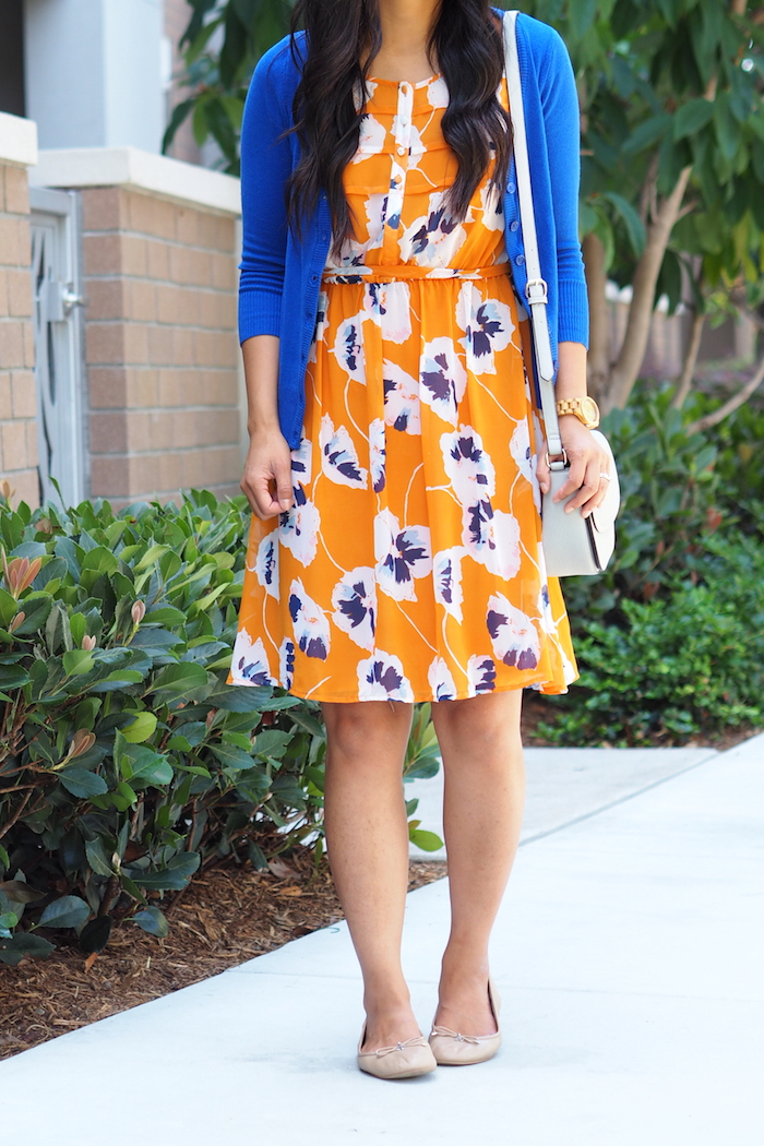 orange floral print dress + bright blue cardigan + nude flats + light accessories