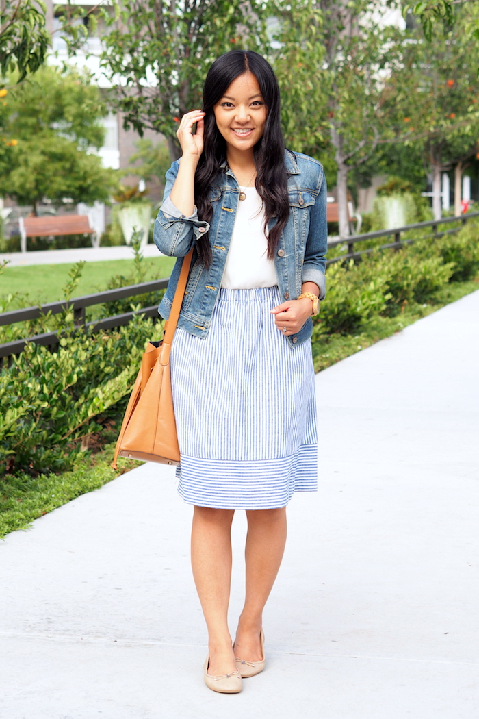 white top + striped skirt + denim jacket + nude flats
