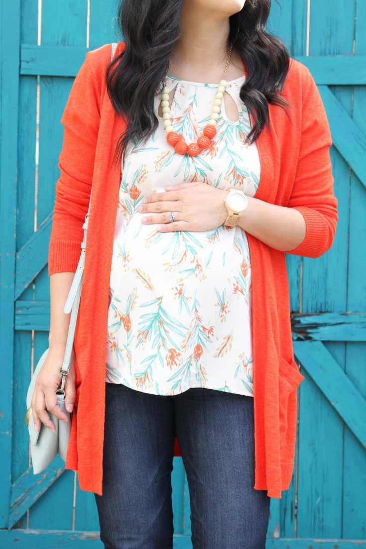 White Floral Print Blouse + Orange Cardigan + Jeans + Statement Jewelry