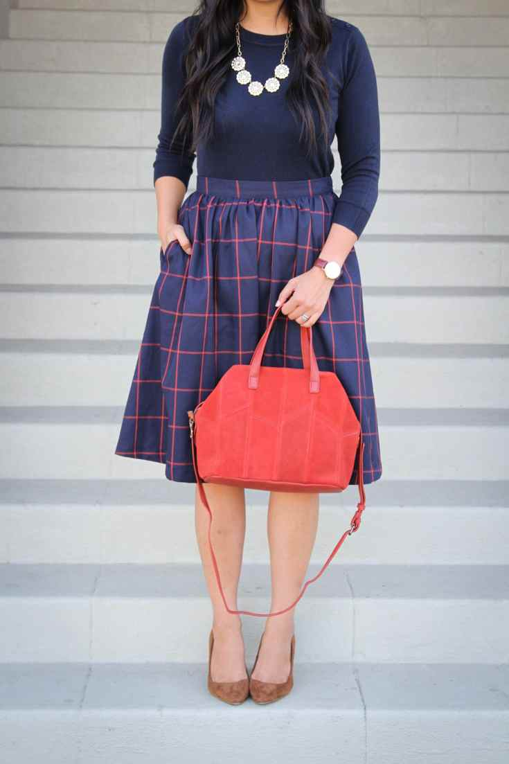 Navy Pullover Sweater + Statement Necklace + Blue and Red Skirt + Heels