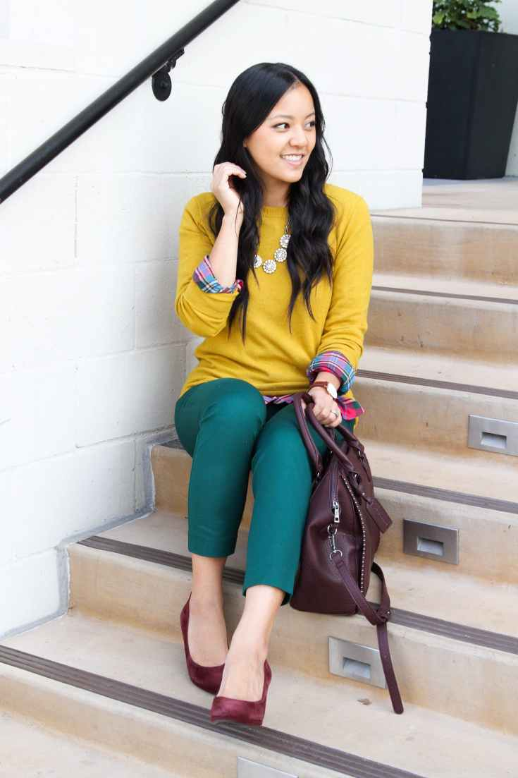 Green ankle pants + yellow sweater + plaid top + statement necklace + maroon pumps