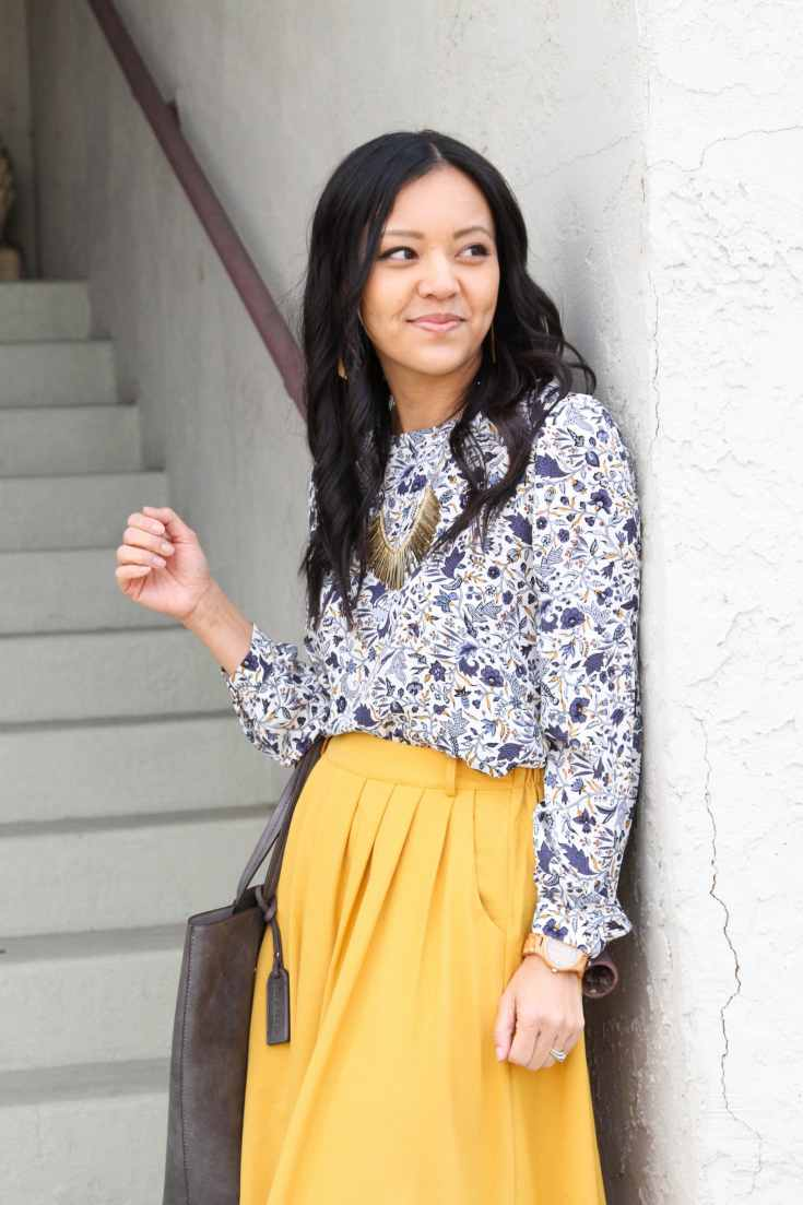 yellow skirt + white floral top + statement necklace + wooden watch