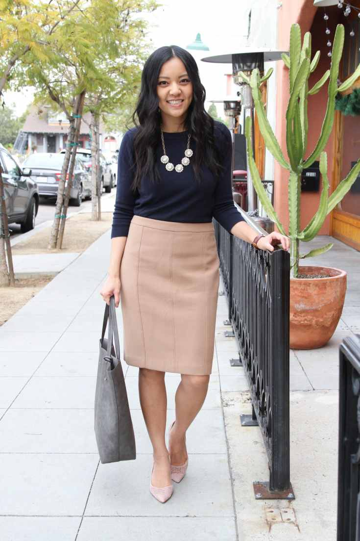 Business Casual: Navy sweater + Tan Skirt + Blush pumps + Grey tote