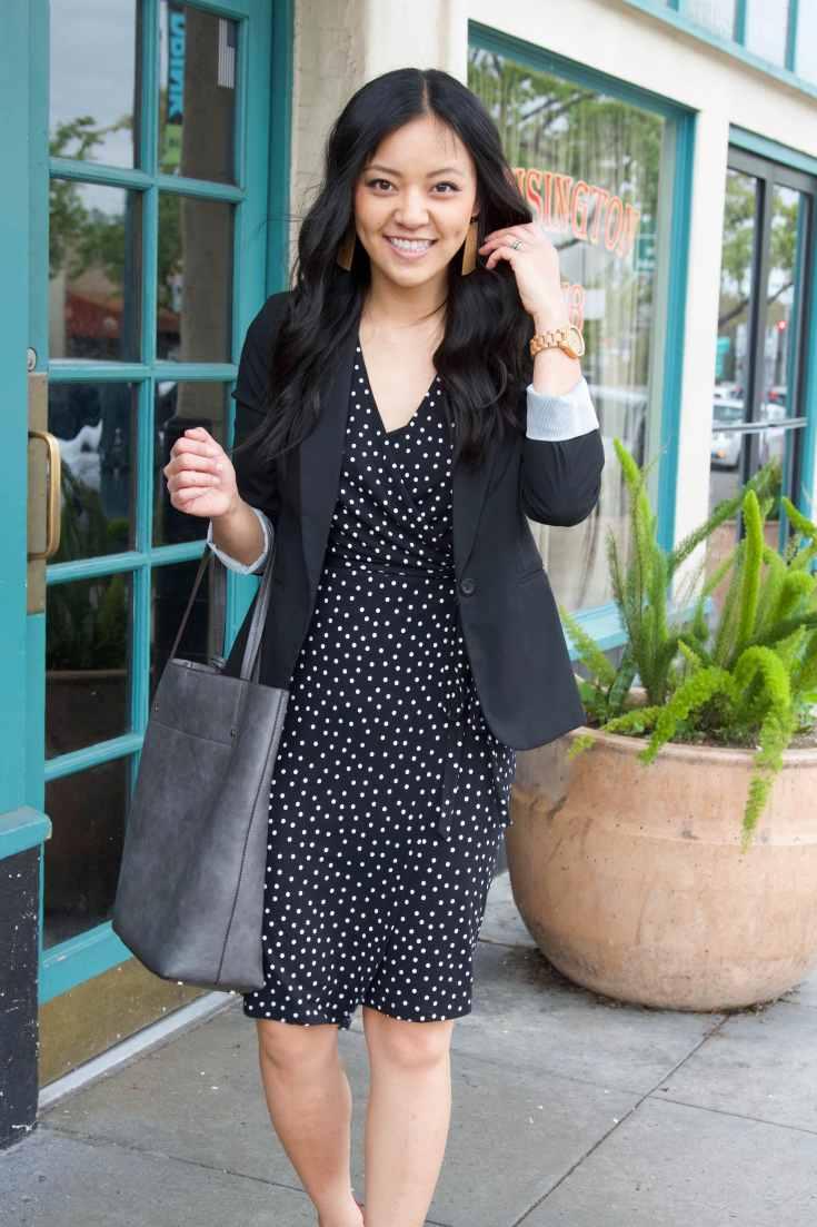 wooden watch + polka dot black dress + black blazer + grey tote + brown earrings