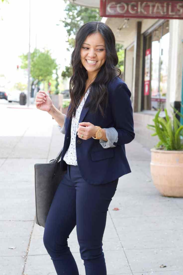 blue pants + white floral shirt + blue blazer + grey tote + wooden watch