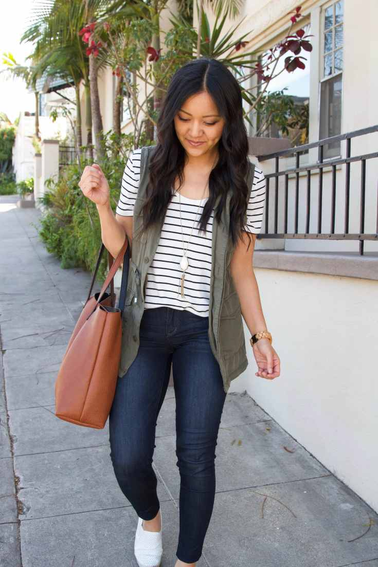 olive utility vest + skinny jeans + brown tote + pendant necklace + striped tee