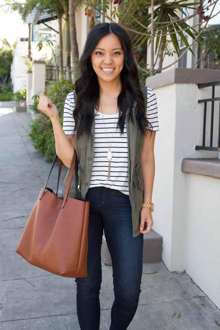 olive utility vest + striped tee + skinny jeans + brown tote