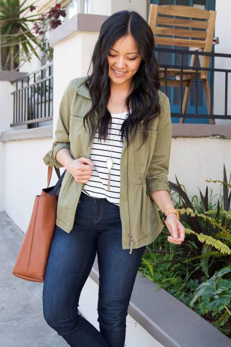 striped tee + skinny jeans + olive utility jacket + brown tote