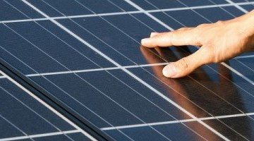 The electric grid's latest threat? Rooftop solar cells