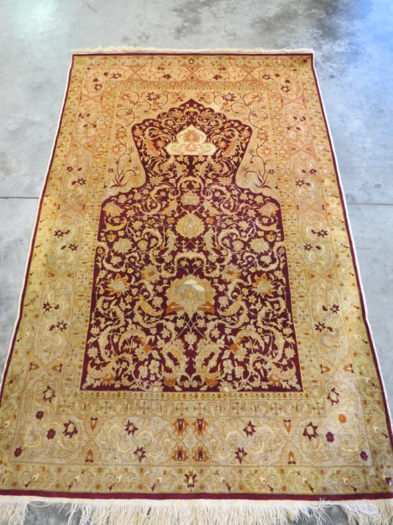Picture of a Fine Antique Rug at a front view