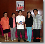 Jerry of BLE-DOLE is flanked by DOLE representative, his wife, Ms. Nel and Jojo.