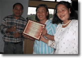 PWAG Board member Dandy Victa pose together with Mss. Jean Sessay and Godelyn Iremedio.