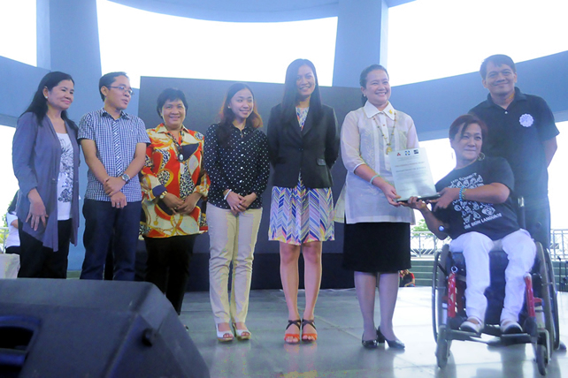 DOJ officials receive the PWD Friendly Website Plaque from NCDA Executive Director Carmen Zubiaga.