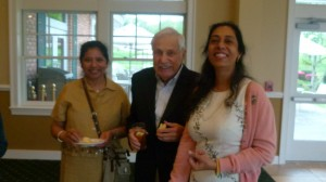 Library Trustee Myron Blumenfeld with guest and FOL Treasurer Tinu Thakore (right)