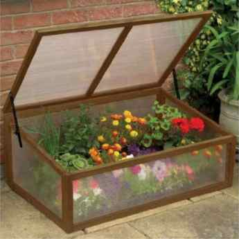 Protect them tender plants with this attractive wooden cold frame.