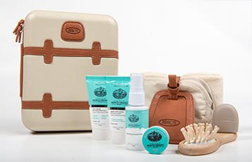 Qatar Airways First Class female amenity kit bags created by luxury luggage designer BRIC's offered on long haul and ultra long haul flights