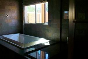 His master bath has a steam shower and soaking tub