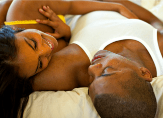 Black couple in bed