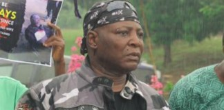 Charly Boy protesting in the rain