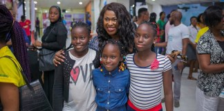 Uche Jombo and young fans at the screening of Banana Island Ghost at the cinema