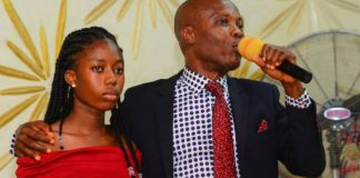 Pastor Kayode Olawuyi shows Miss Treasure Bamgbose to the congregation at Redeemed Church